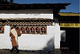 Buddhist monk and prayer wheels