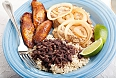 A classic Cuban dinner of roast pork, black beans and rice, and fried sweet plantains