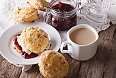 Scones with jam, clotted cream and tea with milk