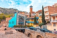 Architecture of the Old Town of Tbilisi, Georgia, in Abanotubani area. Domes of sulfur baths, carved balconies...