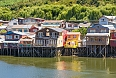 Castro, a city on Chiloé Island in Chile's Lake District. Colourful wooden stilt houses line the waterfront.